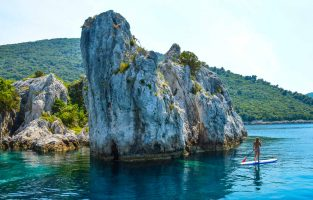Stand Up Paddling while on the Dubrovnik Sailing Adventure tour | Raftrek travel